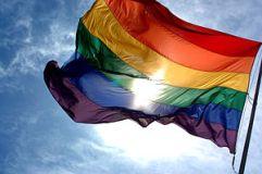 300px-Rainbow_flag_and_blue_skies